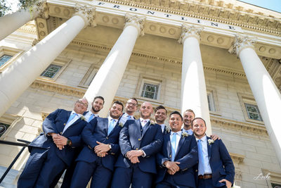 The Groom and Groomsmen Pose for Wedding Day Portrait