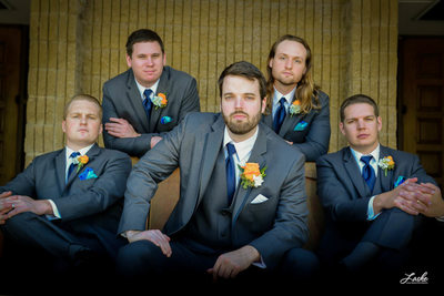 Groom and Groomsmen Pose Straight-Faced on Wedding Day