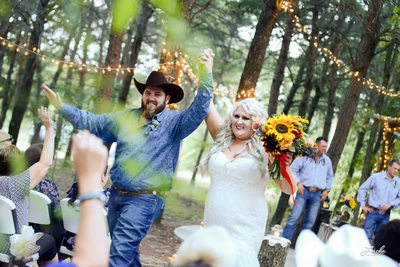 Bride and Groom cheer their new life together