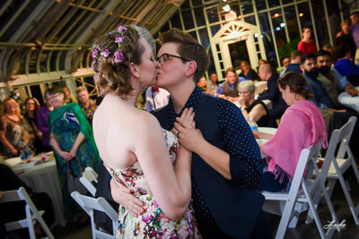 Same Sex Couple Kisses At Reception