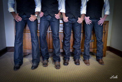 Groomsmen show off their blue jeans and boots