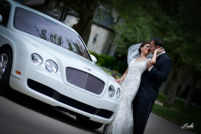 OKC Wedding Photographers Bride Turns Back Toward Groom and Pulls Him Close for Kiss by Bentley