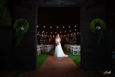 Bride Smiles for Camera in Outdoor Venue