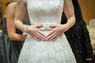 Close Up of Bride's Hands and Wedding Dress