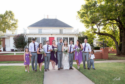 Couple Walks With Wedding Party