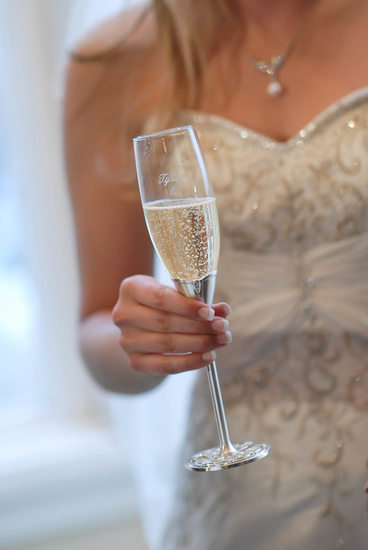 Closeup of Champagne Glass in Bride's Hand
