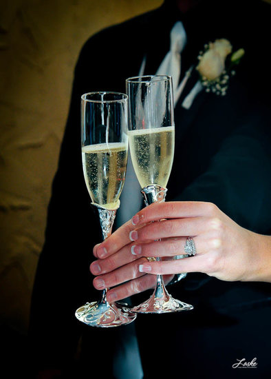 Bride and Groom Cheers with Champagne Glasses