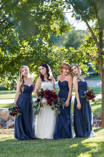 Fun Picture of Bride and Bridesmaids Posing Outside on Wedding Day