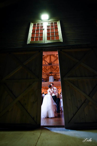 Bride and Groom Dancing Sneak Peek in Barn