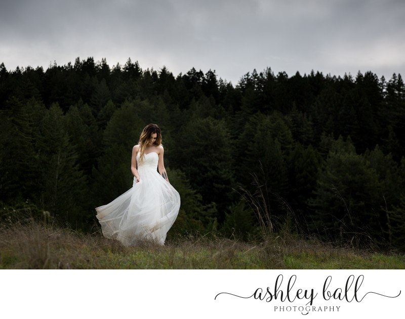 Free Spirited Bride Dancing In The Californian Woods