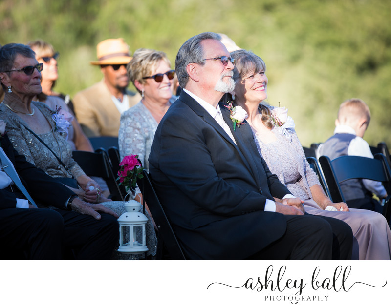 Father and Mother of the Bride Watching The Ceremony