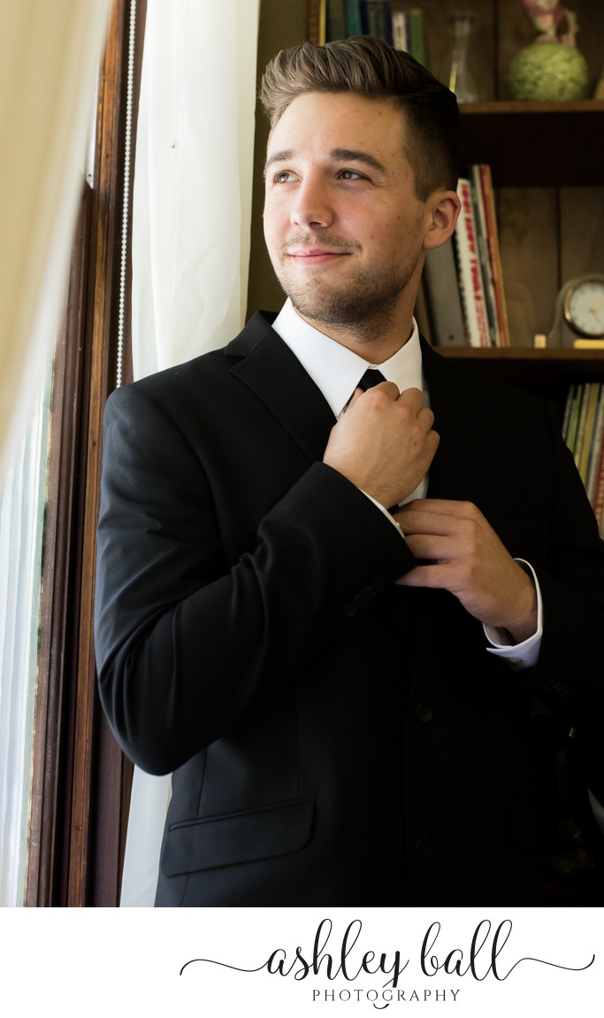 Groomsman getting ready at Joyful Ranch wedding venue