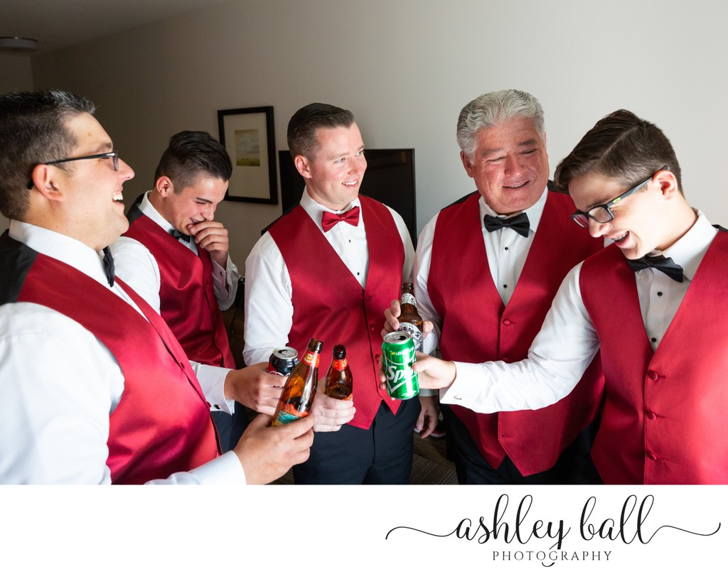 Groomsmen toast while getting ready for wedding