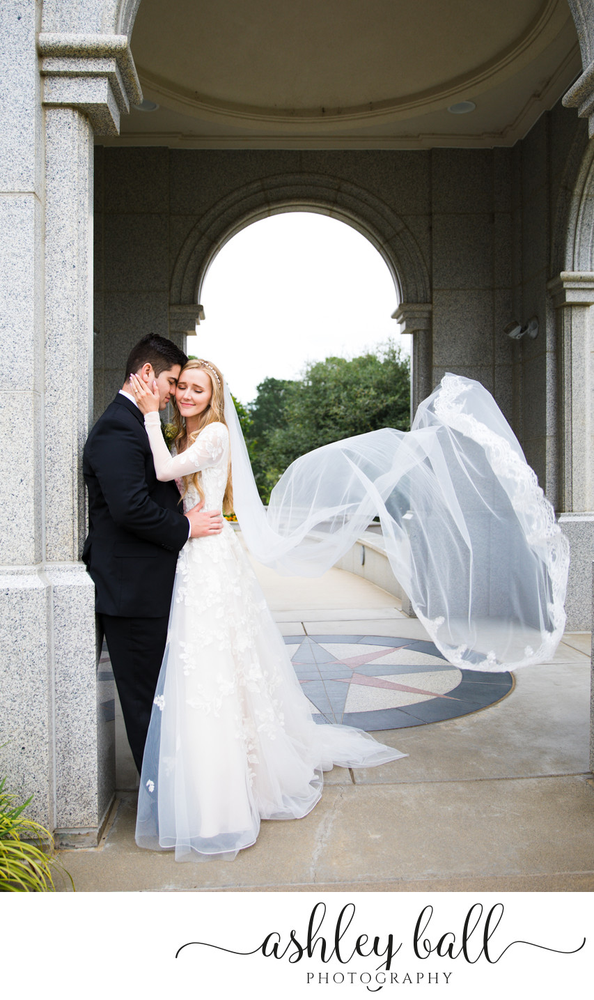 Bride and groom at Sacramento temple in archways
