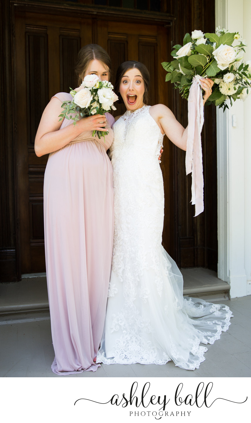Candid photos of bride with bridesmaid in Vacaville, CA