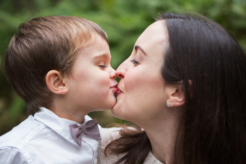 mom kissing son