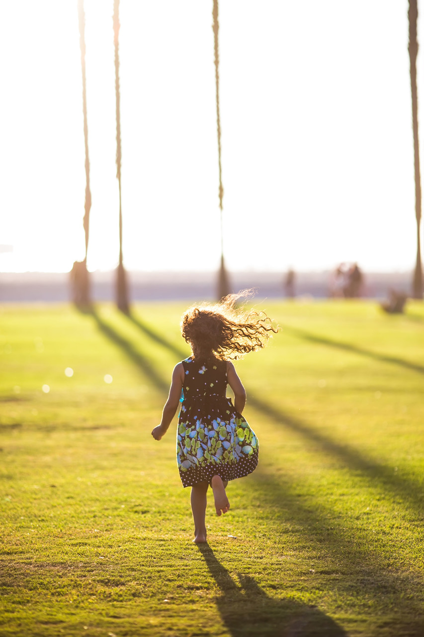 girl running to the beach