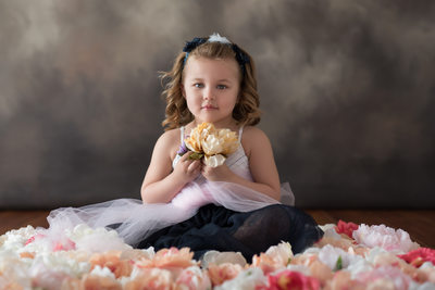 Portrait of Little Girl With Flowers