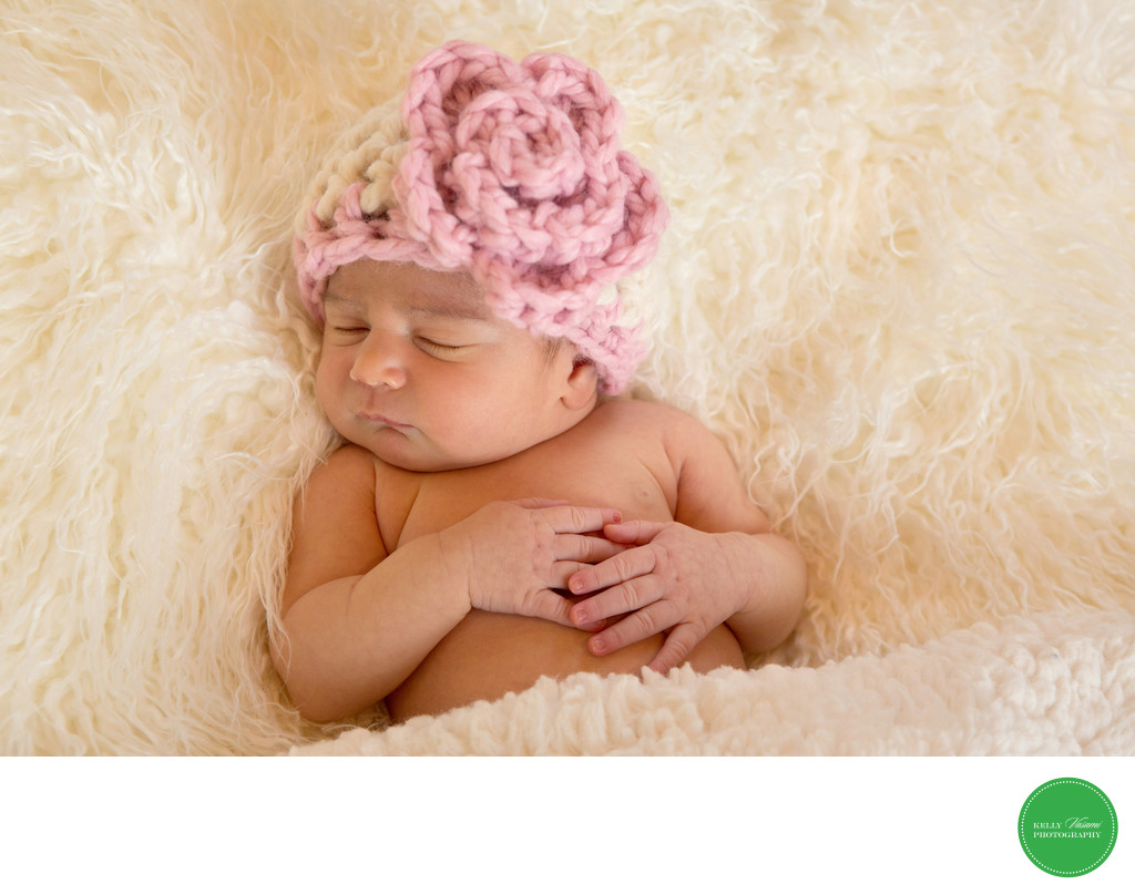 Newborn baby wearing pink knit hat Westchester