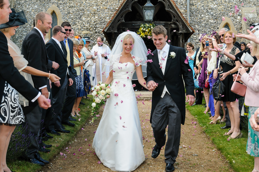 Throwing Confetti at Henley Wedding