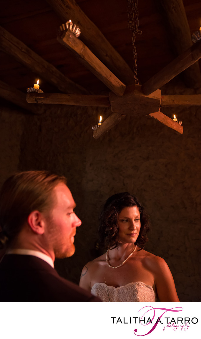 Adobe walls and candle light for an intimate wedding ceremony