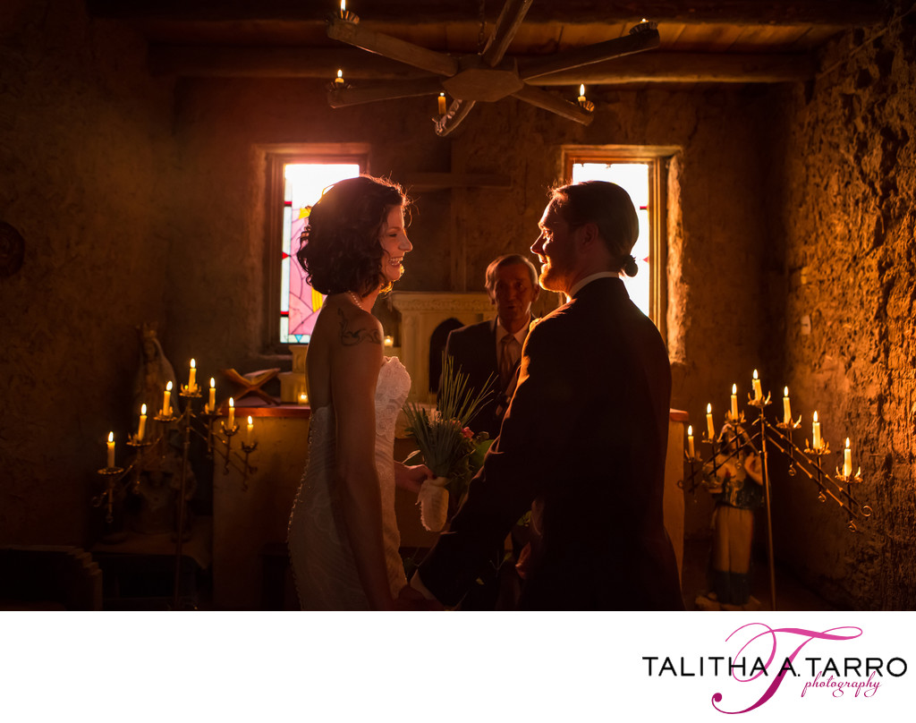 Candlelit wedding ceremony in the adobe walled chapel