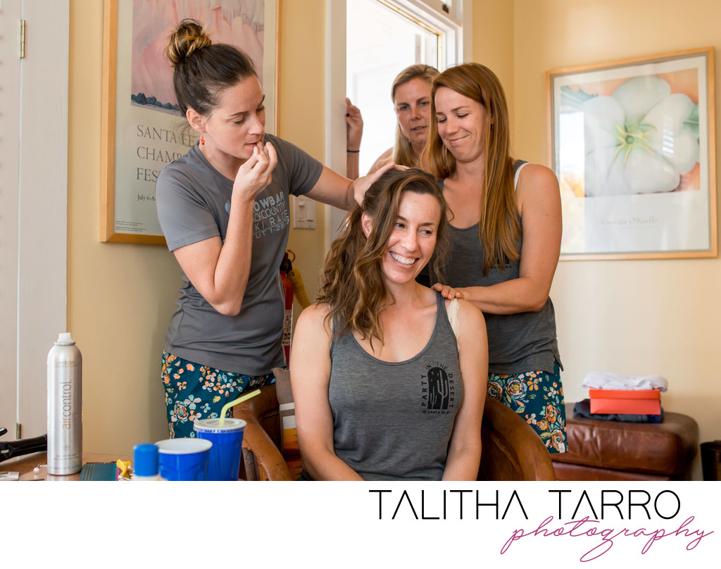 Bridesmaids getting the bride ready for her big day