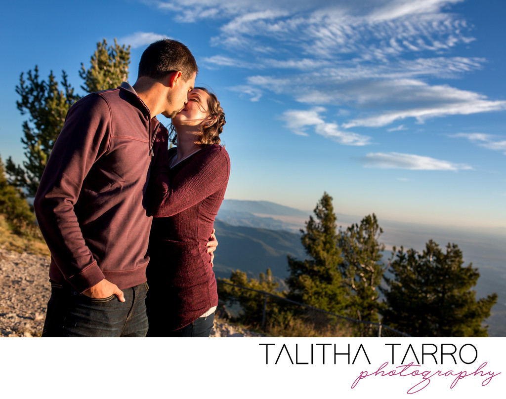 couple kissing on top of the mountain