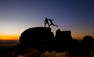 Jumping boulders at sunset