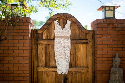 White lace dress hanging in front of Santa Fe gate