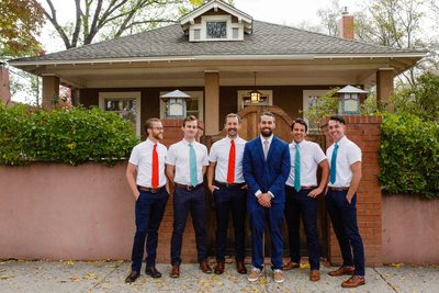 Groom and groomsmen posing for a picture