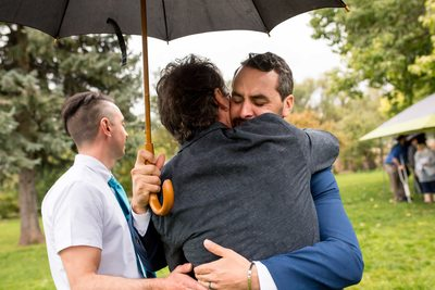 Groom hugs guests