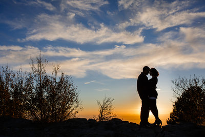 Couple silhouette on the mountain top