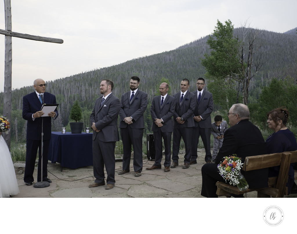 Wedding groom at the altar with groomsmen