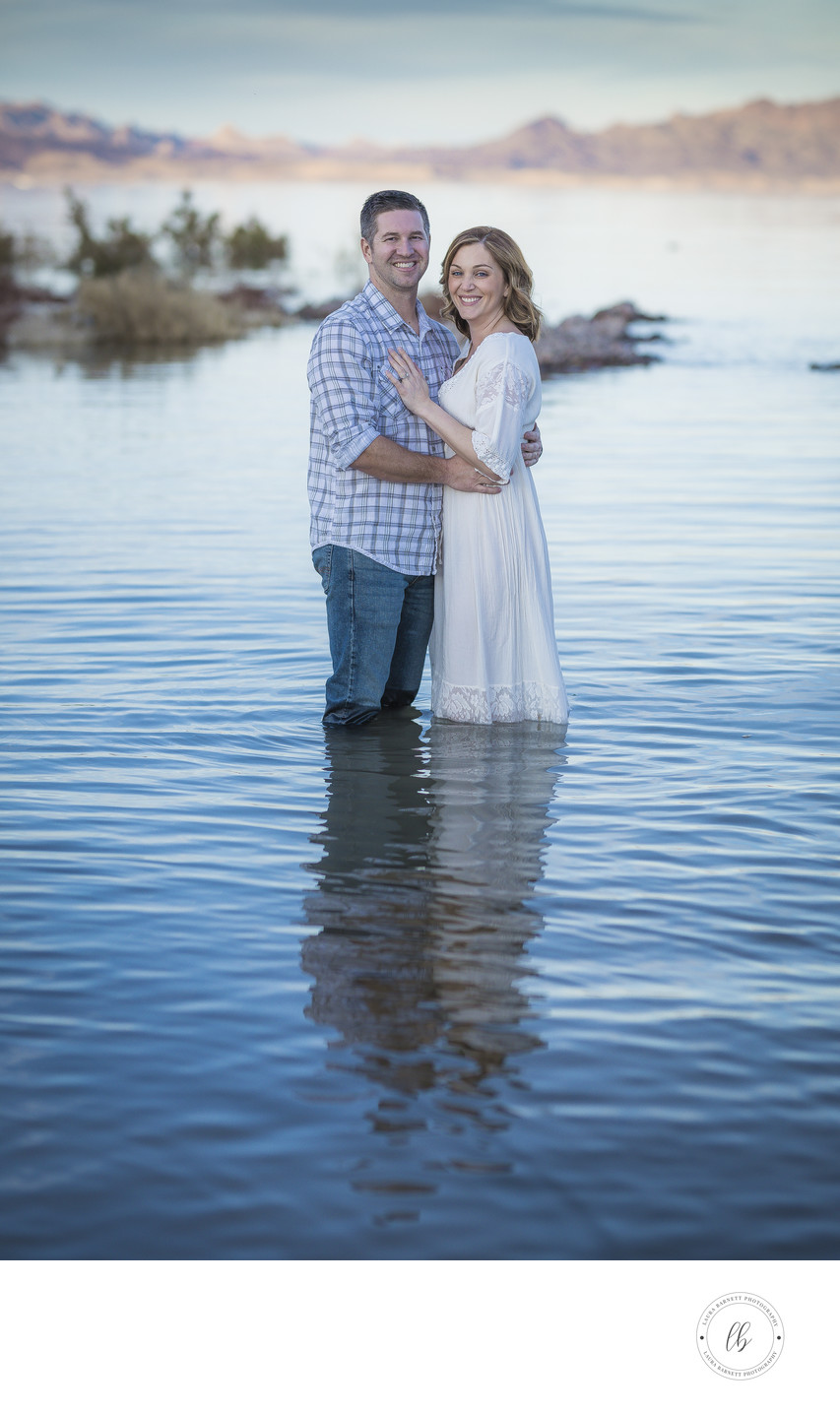 A couple standing in the Lake for pictures