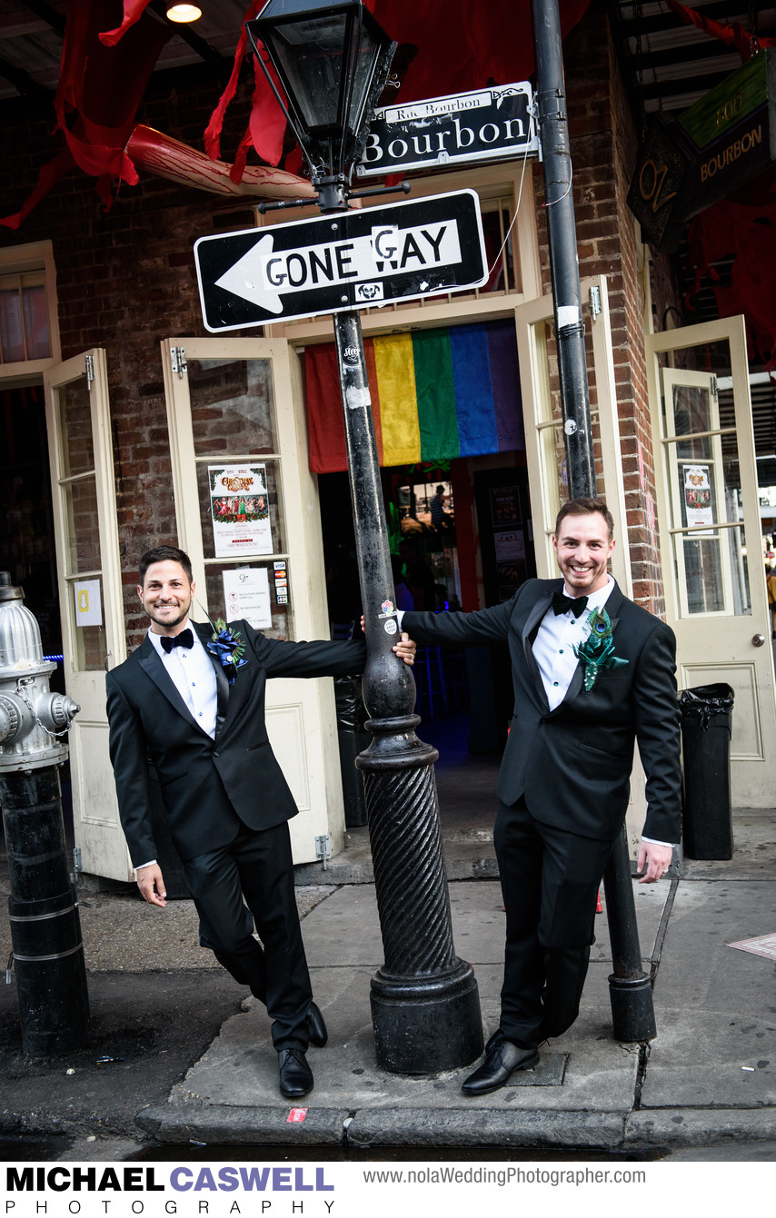 Two Grooms by Gone Gay Street Sign