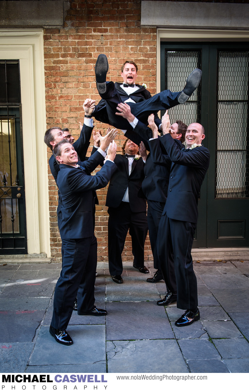 Groomsmen Toss Groom in Air