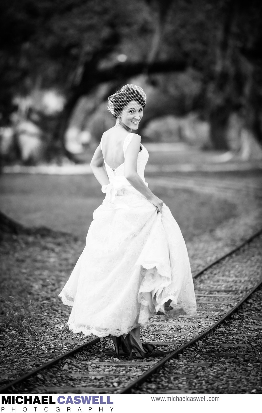 Bride on Railroad Tracks in City Park