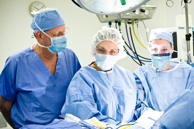 Surgical team performs operation