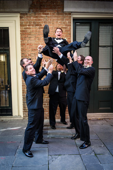 Groomsmen Toss Groom in the Air