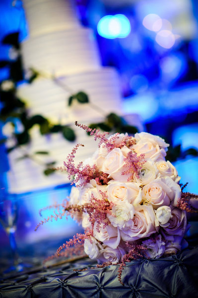 Bride's Bouquet with Cake in Background