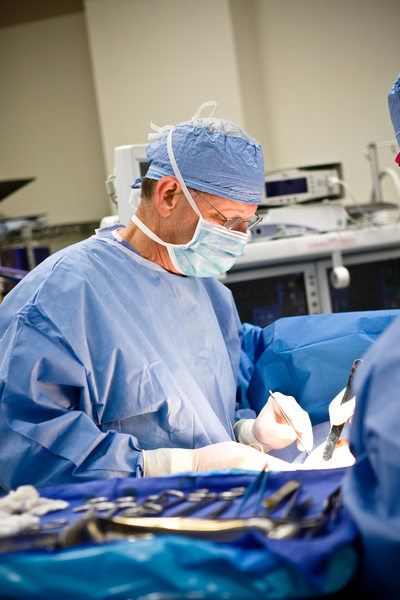 Surgeon operating on patient