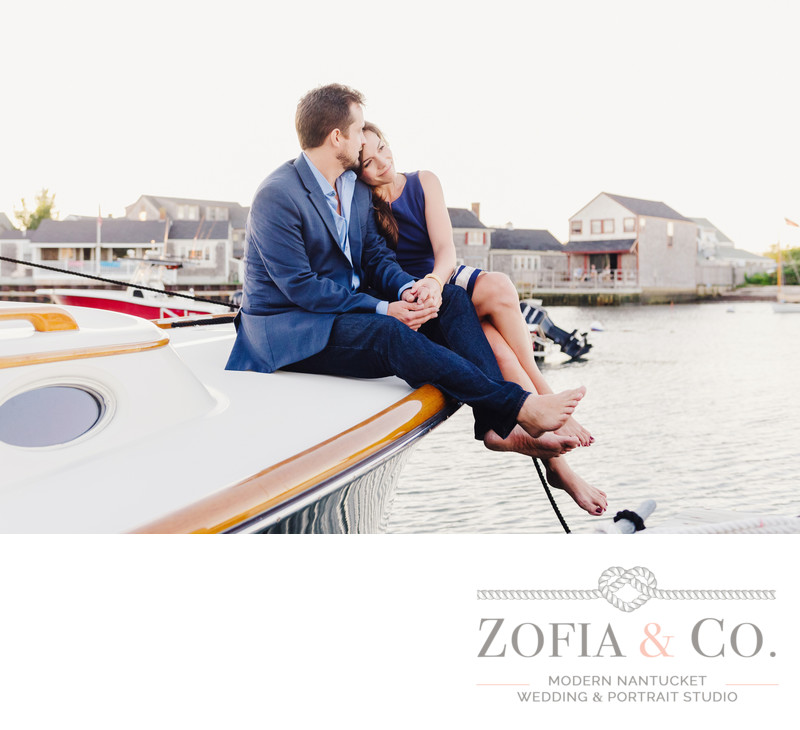 engaged couple on boat in harbor