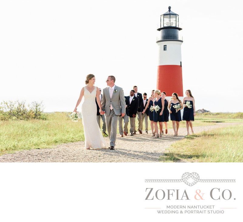 wedding couple with party at sankaty lighthouse