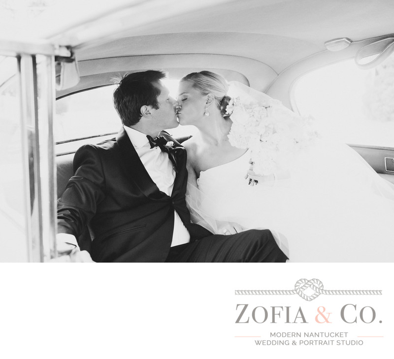 Newlyweds kiss in vintage Nantucket car
