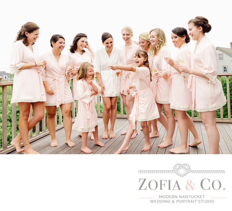 Bridesmaids and flower girls in pink robes