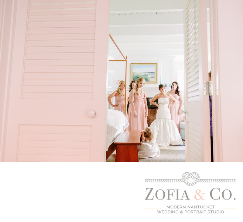 Bridesmaids through pink door