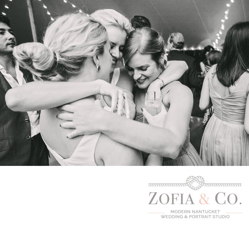 Emotional Nantucket Reception hug bride and bridemaids