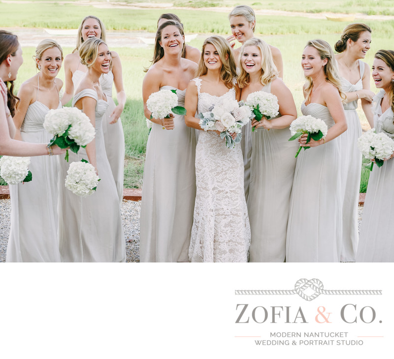 Great Harbor Bridesmaids with white bouquets in grey