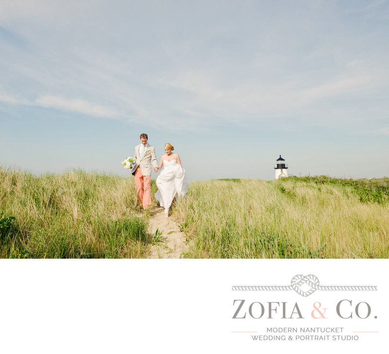Wedding couple walk at Brant Point Lighthouse